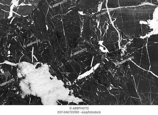 Black polished marble backgound detail. Indoor decoration. Horizontal