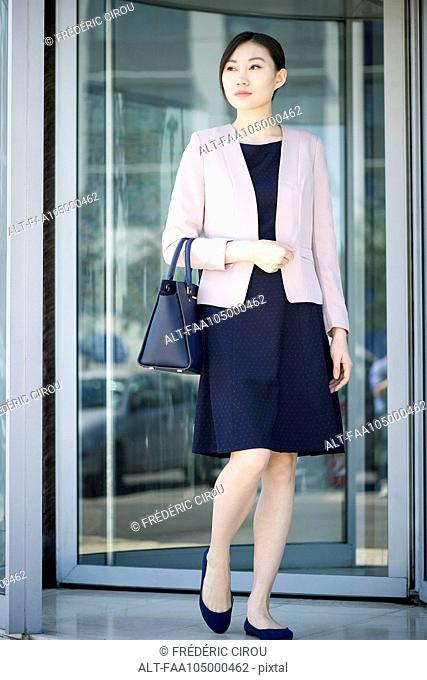 Businesswoman exiting building