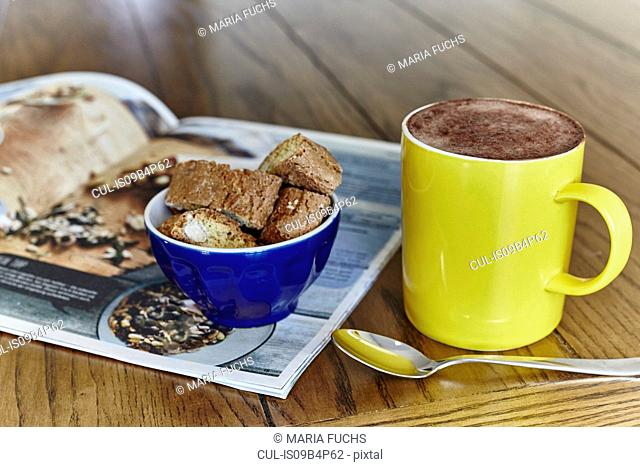 Still life of hot chocolate with sweet snack in bowl