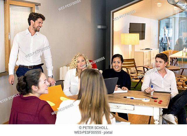 Business people attending a workshop in the office