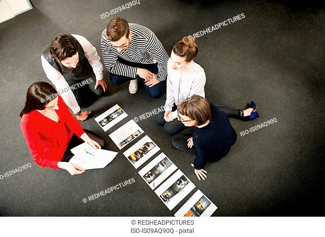 Designers laying out images on floor