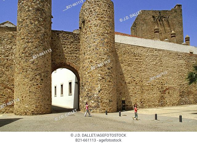 Spain. Badajoz. City walls and 'Puerta de Alconchel' at Olivenza. Back the tower of the castle, built in 1306 (disputed by Portugal)