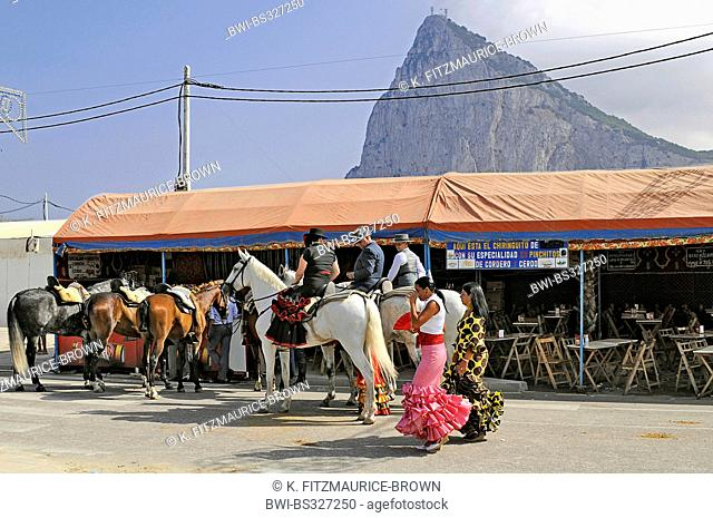 flamenco dancers and horseriders celebrating the annual fair in front of the Rock of Gibraltar, Spain, La Linea De La Concepcion