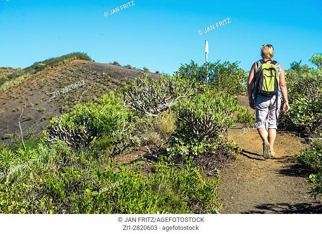 woman walking at bandama crater, gran canaria, spain