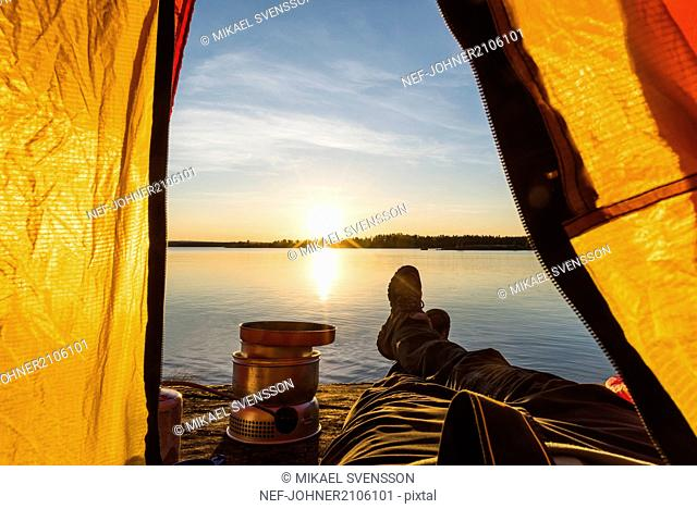 Person in tent at sunset
