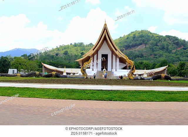 Long shot of a beautiful white Buddhist temple with dragon fountains at Ban Nong Chaeng, Phetchabun Thailand