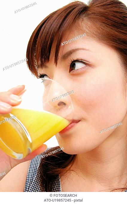 Woman drinking a juice, Close-up