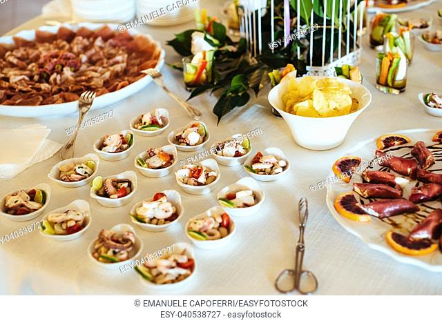 restaurant table prepared with tasting dishes for an aperitif for a wedding party gala dinner
