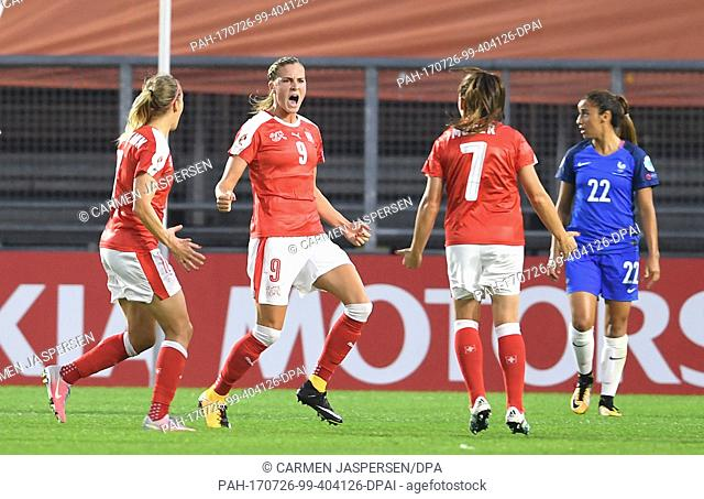 Switzerland's Lara Dieckenmann (L) and Martina Moser (R) celebrate together with the goal scorer of the 1-0 Ana-Maria Cronogorcevic during the UEFAWomen's...