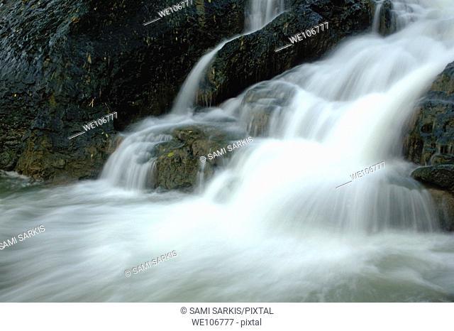 Waterfall cascading into Li Jiang River, Yangshuo, Guangxi, China