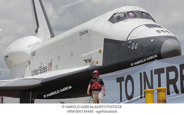 The Space Shuttle Enterprise is being prepared to be transferred to the USS Intrepid Aircraft Carrier to be put on permanent display at Sea and Space Museum on...