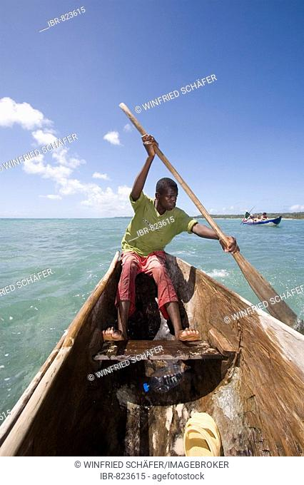 Man in a boat crossing channel to Nosy Nato Island, Madagascar, Africa