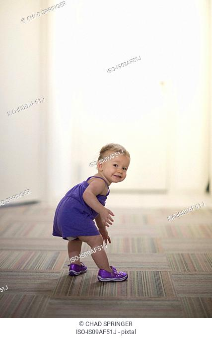 Portrait of toddler girl wearing purple clothes