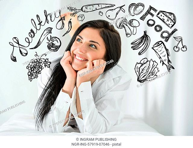 Young pretty woman thinking of healthy food closeup face portrait and sketches overhead