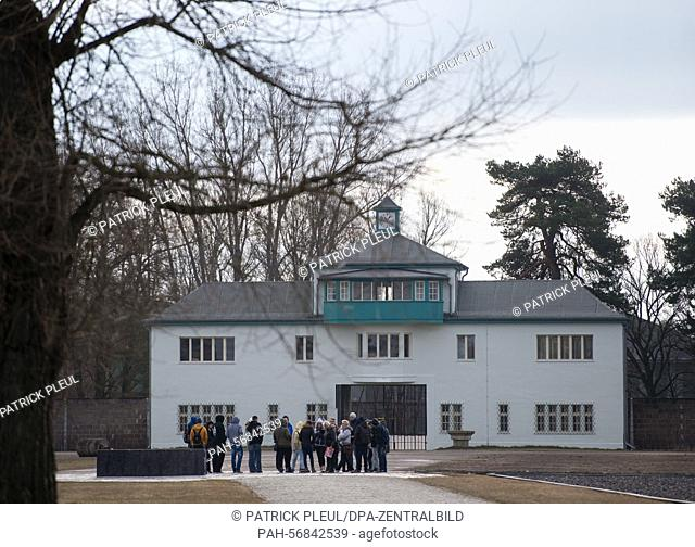 Visitors of a guided tour stand in front of the main gate house at the former concentration camp Sachsenhausen in Oranienburg, Germany, 5 March 2015