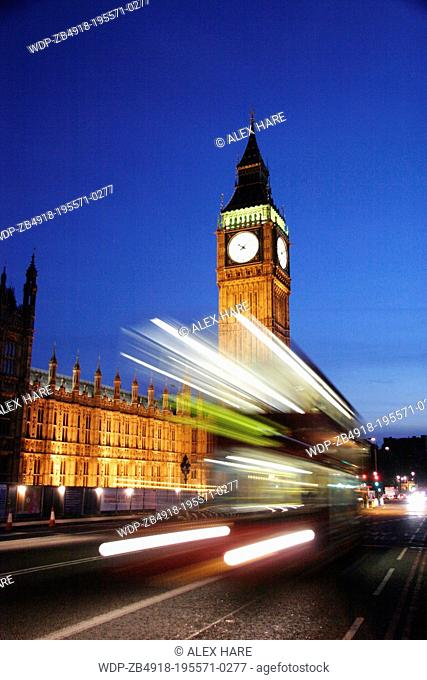 Traffic streams over Westminster Bridge at night leaving trails of light in front of Big Ben and the Houses of Parliament