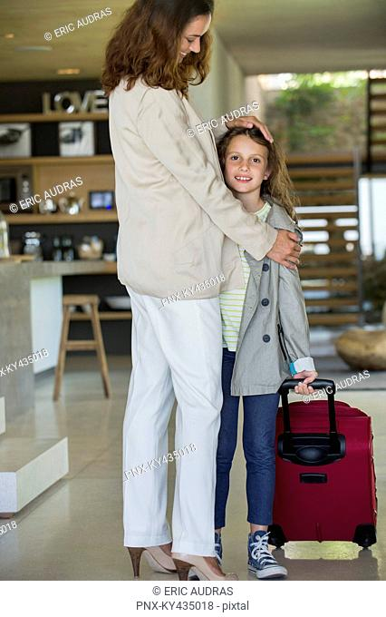 Woman welcoming her daughter arriving from holidays