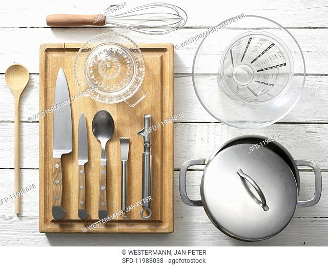 Kitchen utensils for preparing orange couscous with vegetable salad