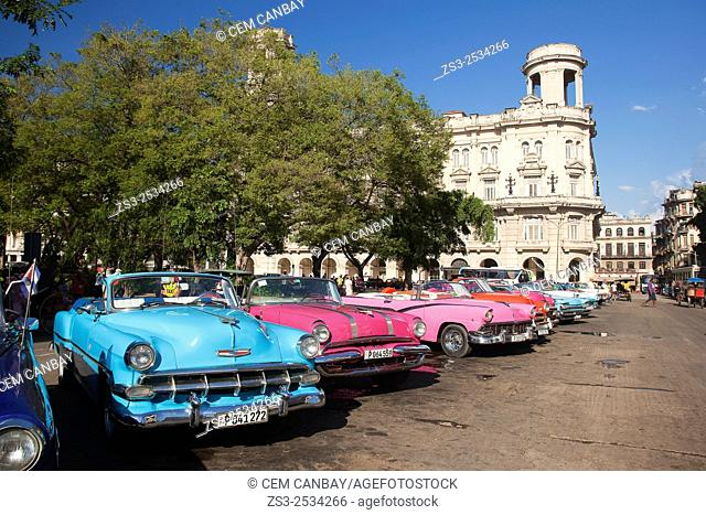 Colorful vintage American cars near the Jose Marti Park in Central Havana, Cuba, West Indies, Central America