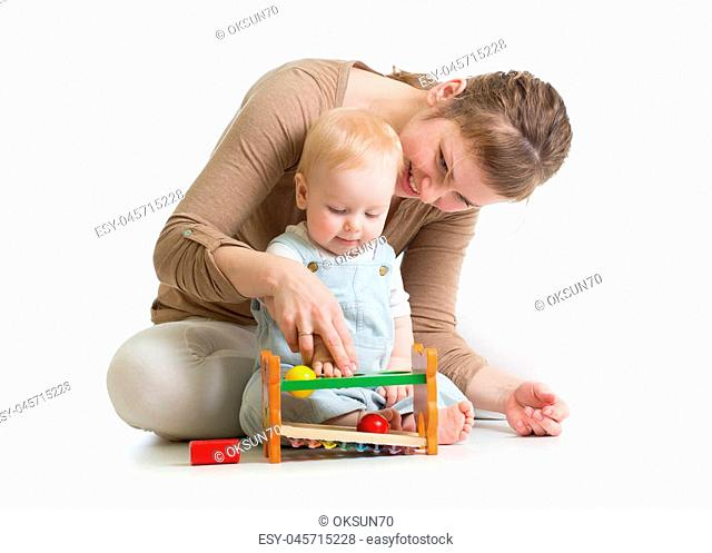 baby boy and mother playing together with developmental toy