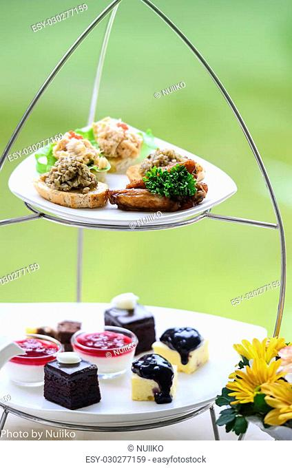 table set for high tea with sweet cookies selective focused