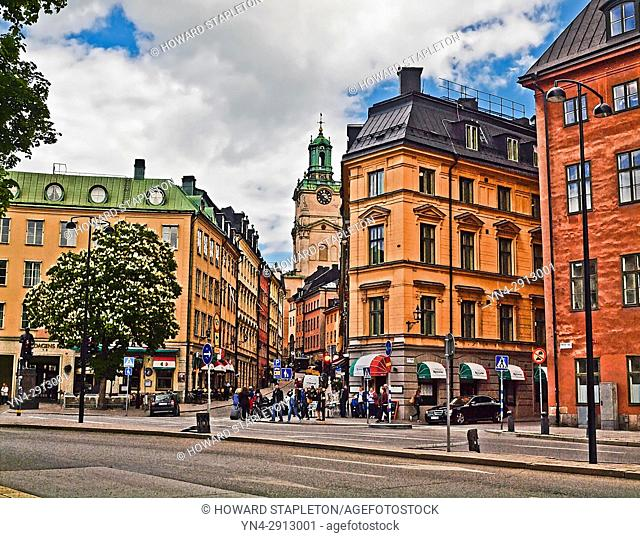 Old town Stockholm with the clock tower of the Church of St. Nicholas (Sankt Nikolai kyrka) also known as Storkyrkan (The Great Church) and Stockholms Domkyrka...