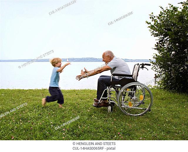 boy running into arms of senior man
