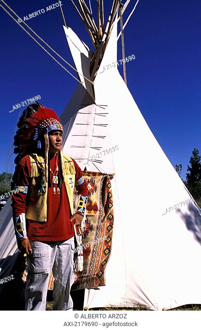 Crow Indian dressing up in traditional robes for the Parade during an annual Crow fair, Crow Reservation; Montana, United States of America