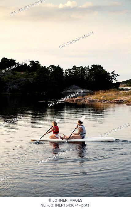 Two sisters kayaking