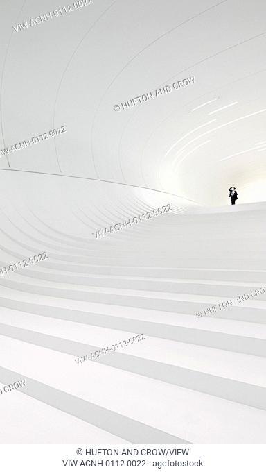 Heydar Aliyev Cultural Center, Baku, Azerbaijan. Architect: Zaha Hadid Architects, 2013. Grand, curved all white stairway