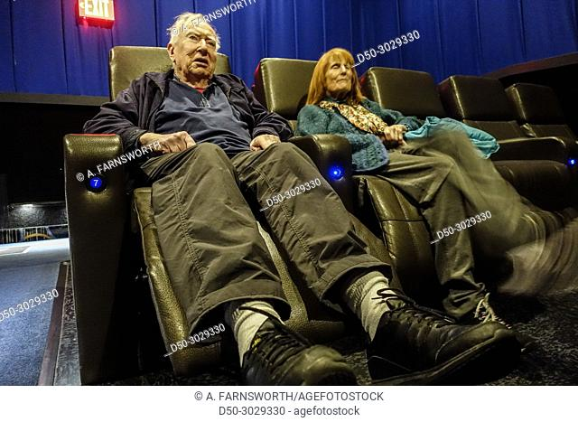 Retired couple in the movie theater. Prince Frederick, Maryland, USA