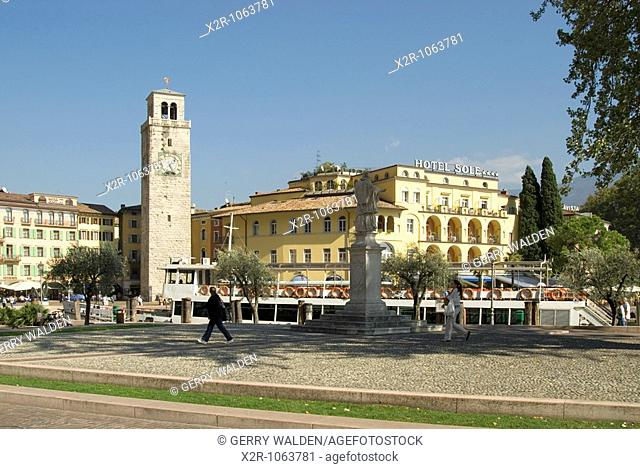 The small town of Riva del Garda at the north end of Lake Garda with the mountains in the background in Lombardy Italy  Dominant is Piazza Tre Novembre...