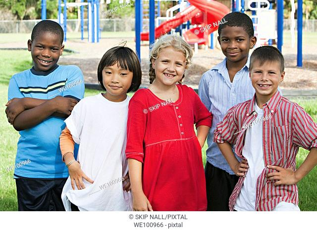 Group of children on a school playground looking at camera