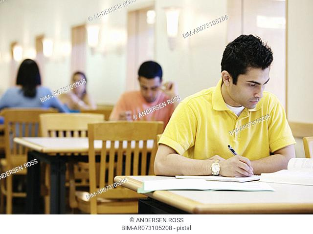 Teenagers working in library
