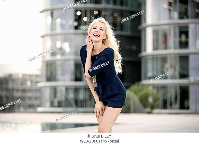 Laughing blond woman posing