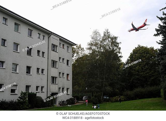 Berlin, Germany, Europe - An Air Berlin passenger jet is flying over residential buildings in Berlin's locality of Reinickendorf shortly before landing at Tegel...
