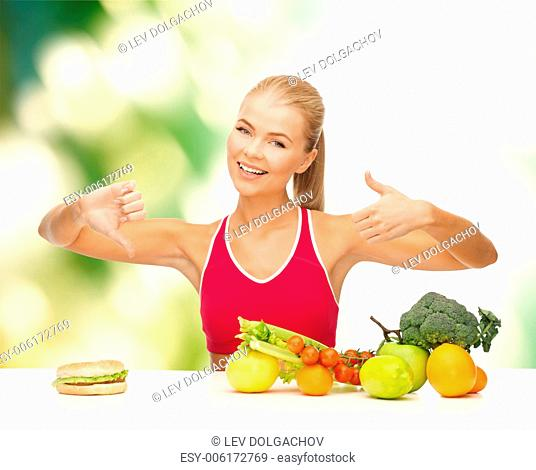 fitness, healthcare and diet concept - smiling woman with fruits and hamburger showing good and bad signs