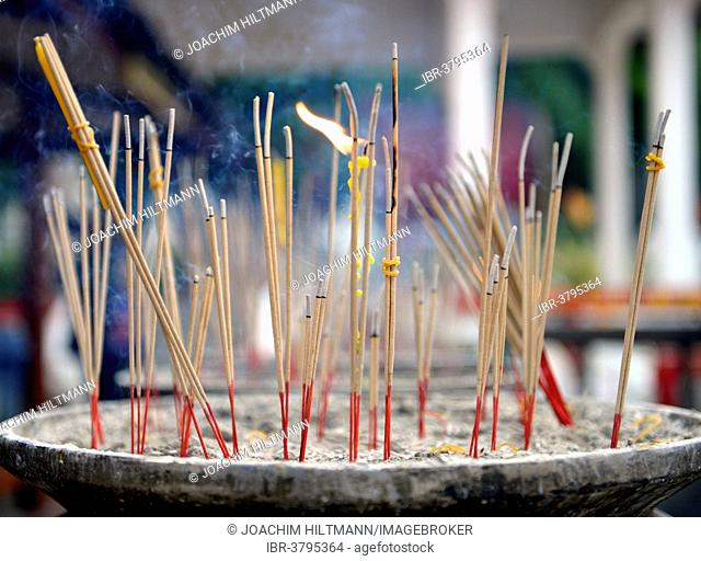 Joss sticks in front of the Wat Phra Si Rattana Mahathat Temple, Phitsanulok, Northern Thailand, Thailand