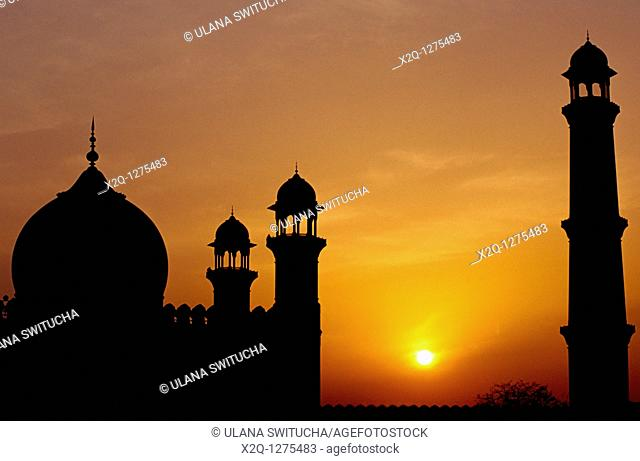 At sunset, a silhouette of the Badshahi Mosque in Lahore Pakistan