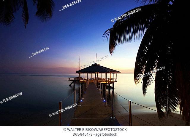 Pier at Coco de Mer Hotel at sunset, Anse Bios de Rose, Praslin island, Seychelles