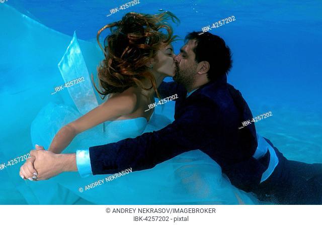 Newlyweds kissing underwater, Indian Ocean, Maldives