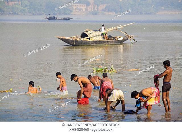 People bathing in Hooghly River, 'ghat' near Hooghly bridge, Kolkata, West Bengal, India