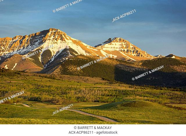 Mountains with early morning light falling on them, Waterton, Alberta, Canada