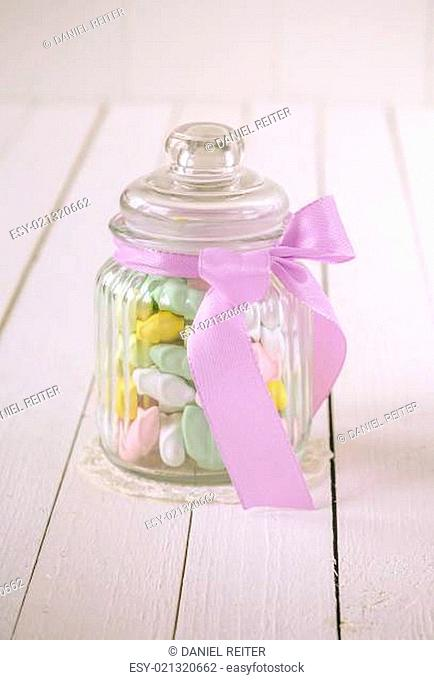 Candy jar filled with sugar covered almonds