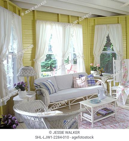 LIVING ROOM : Cottage style, vacation retreat, yellow painted wood slat walls, beams. White wicker with blue and white stripe ticking