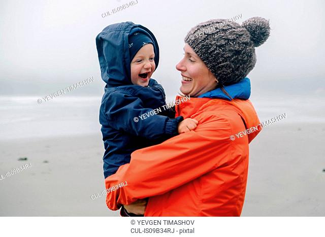 Portrait of mother holding son, smiling, Long Beach, Vancouver Island, British Columbia, Canada