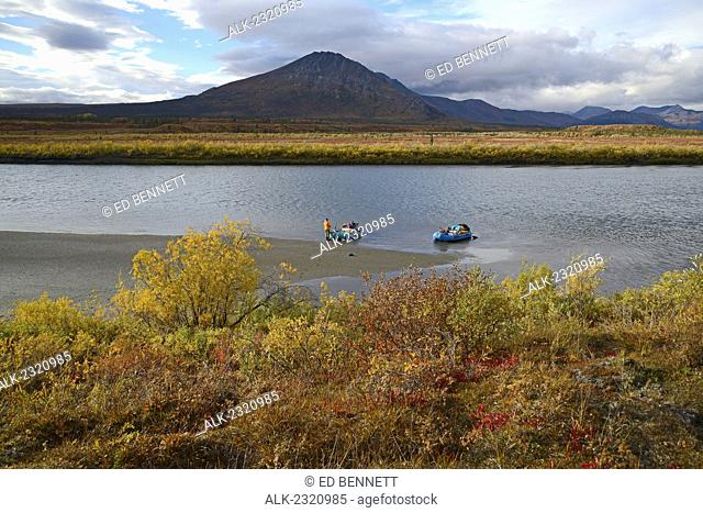 A Man Guards The Rafts Along The Sheenjek River While The Remainder Of His Party Hikes To Kuirzinjik Lake (Lobo Lake) In Arctic National Wildlife Refuge In...