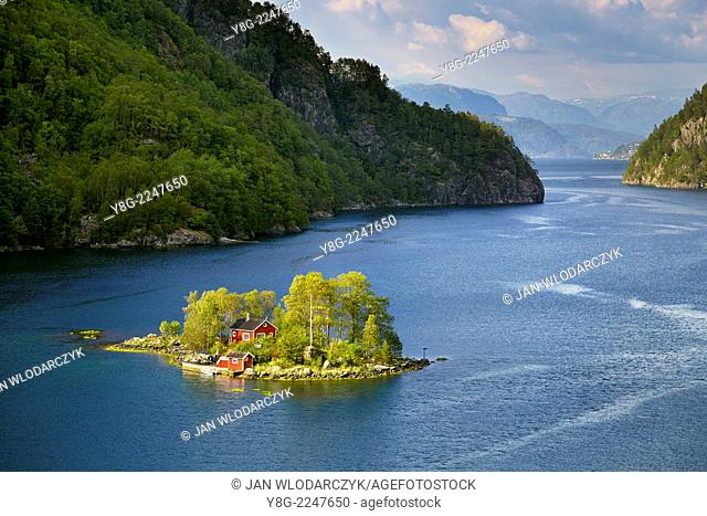 Small Island with a red cottage in Lovrafjord, Norway