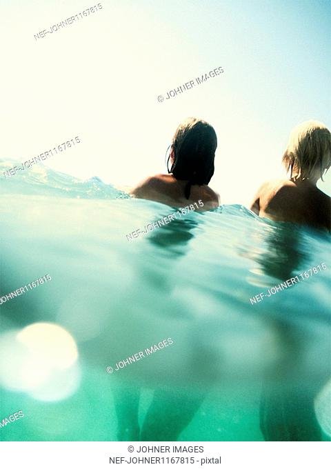 Girls playing in turquoise sea