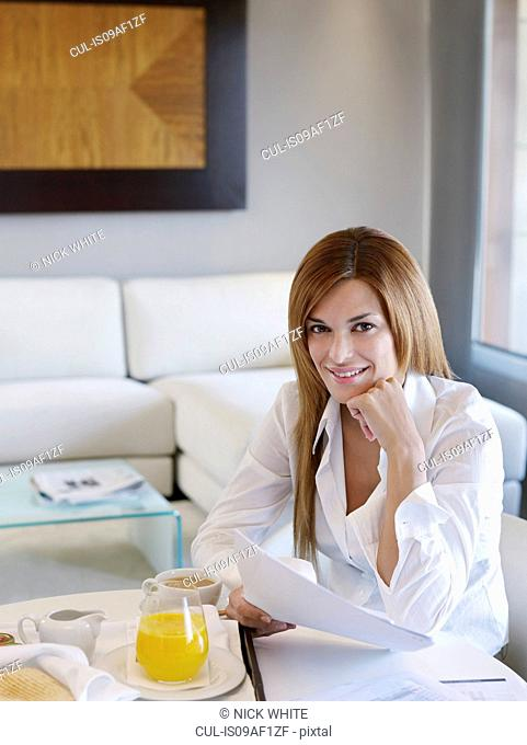 Portrait of young businesswoman working in hotel room